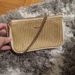 Damaged small coach clutch woven straw bag